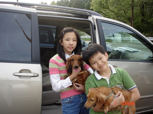 Wang (right) and his sister, with their two dogs, when the family moved to America in 2006 (Photo Credit: William Wang)